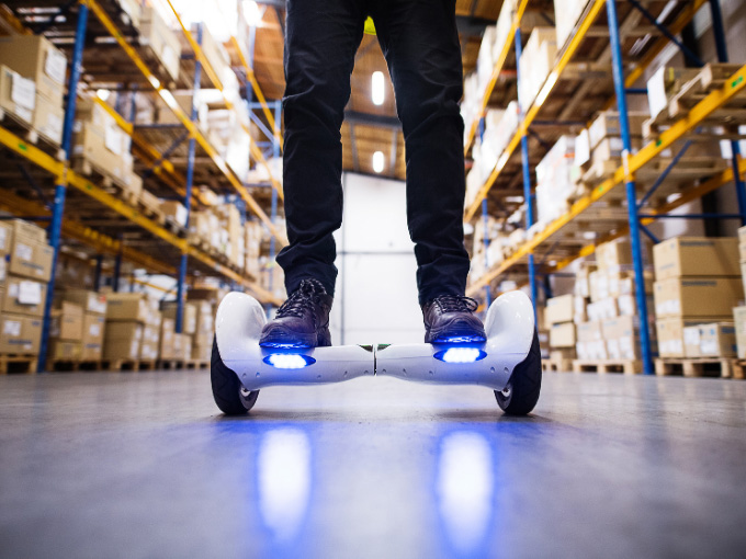 A man testing out and buying a hoverboard