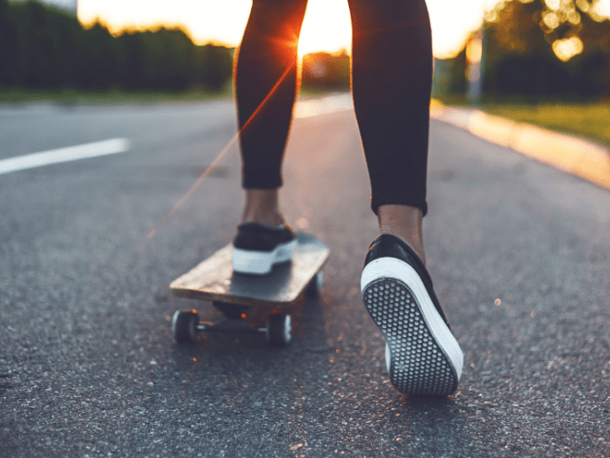 Shot of a woman's legs on a regular skateboard, about to see how fast it can go